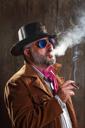 Portrait of a sheriff smoking a cigar photo