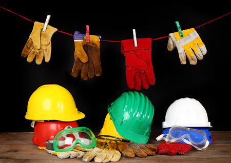 worker safety equipment over black