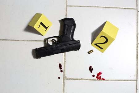 A crime scene with a gun Stock Photo