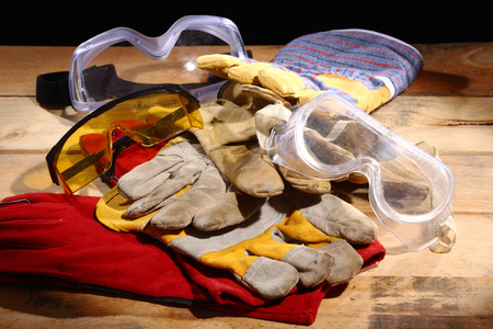 pile of work gloves and goggles