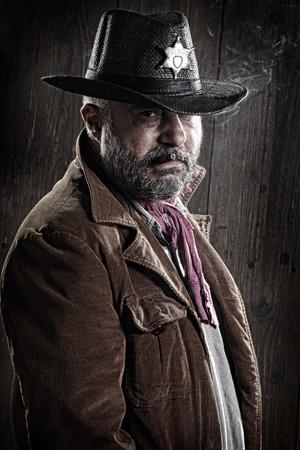 Portrait of a sheriff smoking a cigar