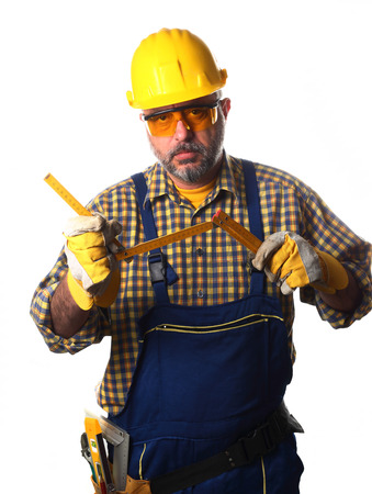 worker with yardstick on white