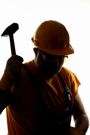 silhouette of a worker with hammer