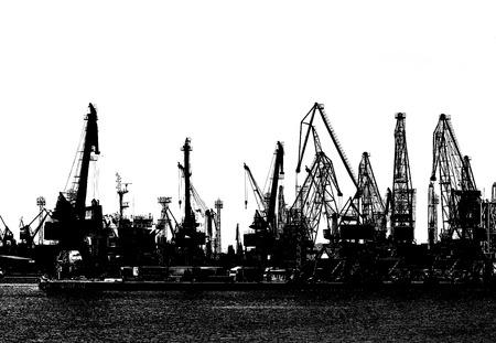 Silhouette of industrial port cranes