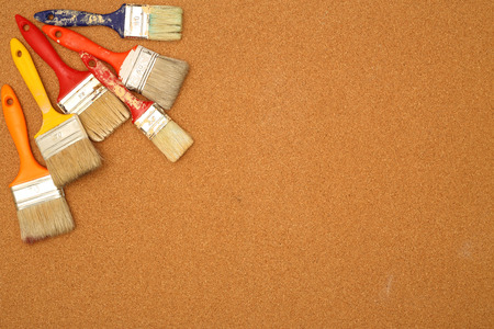 paint brushes on a  cork surface