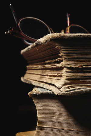 stack of old books and glasses, selective focus Imagens