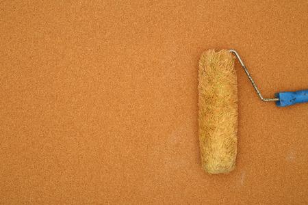 roller brush on a cork surface Imagens