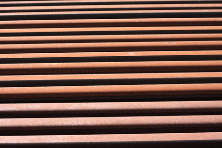 stack of rusty rails background