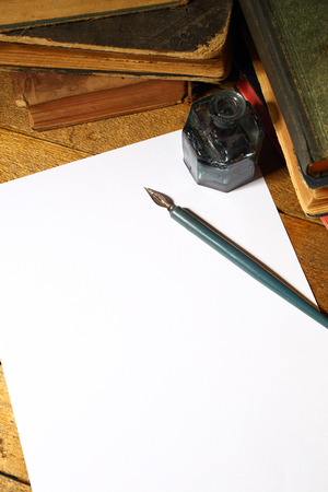 vintage pen and blank sheet