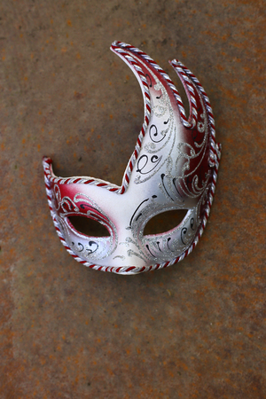 carnival mask on rusty metal background