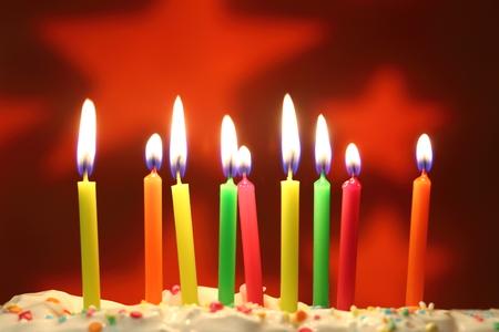 Nine  lit birthday candles close up, shallow dof Imagens