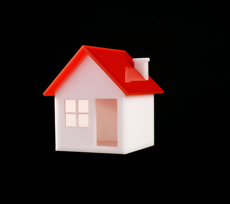 model of a house over black background