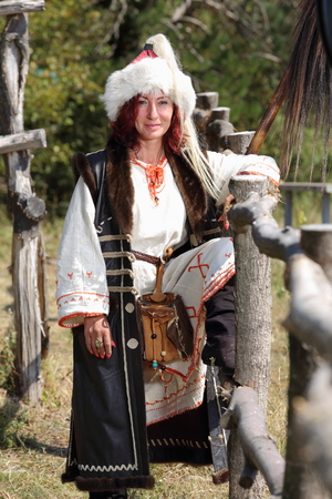a female warrior dressed in Proto-Bulgarian clothes