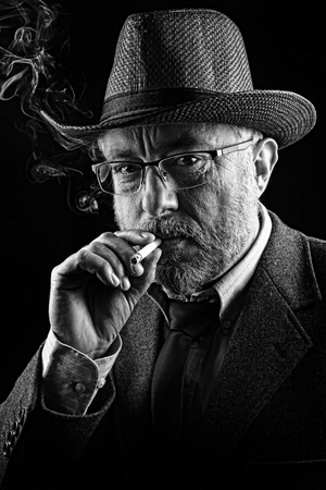 Portrait of a smocking man, black and white