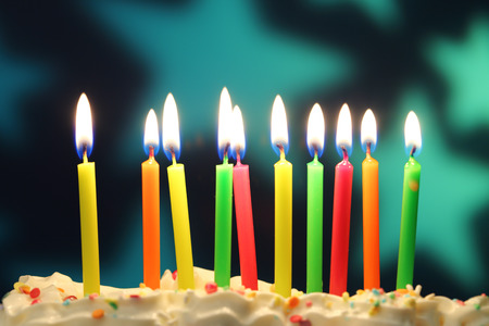 ten lit birthday candles close up shallow dof stock photo picture