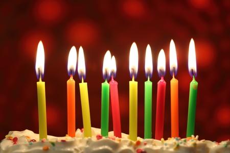 Ten lit birthday candles close up, shallow dof Imagens