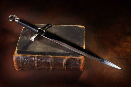 sword and old book close up