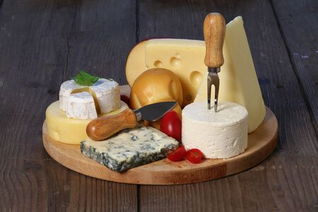 Different kinds of cheese on a wooden board