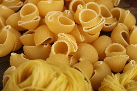 a pile of row pasta, close up 写真素材