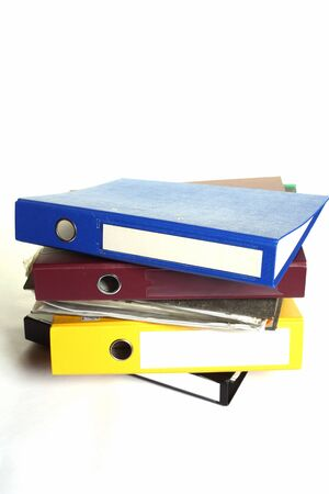 a pile of stationery folders on white Stock Photo