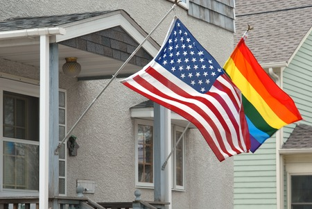 simultaneously: American and rainbow flag waving simultaneously