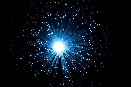 fibre optic: Close, aerial view of an illuminated fibre optic light lamp with black background. Stock Photo