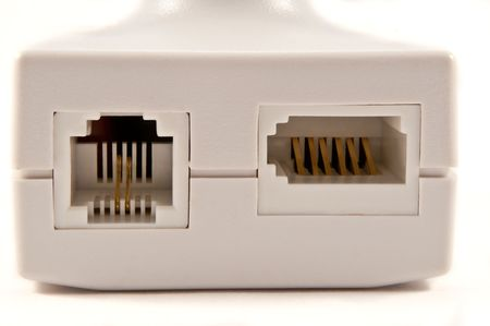 bandwith: Close and low level of an isolated white broadband telephone filter arranged over white. Stock Photo