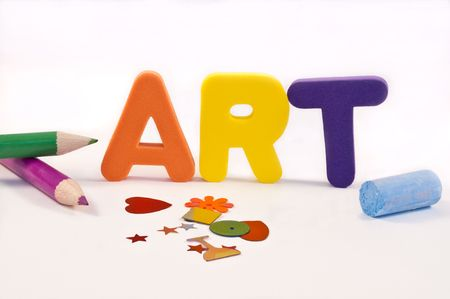 Close and low level of coloured foam letters spelling the word ART over white and surrounded by art materials. Stock Photo - 6864154