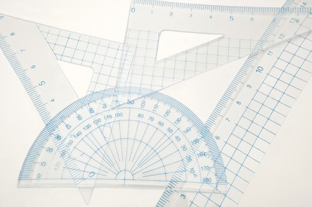 millimetres: Close up of a plastic geometry set arranged over white. Stock Photo