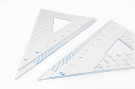 millimetre: Close and low level capturing a plastic geometry set arranged over white.