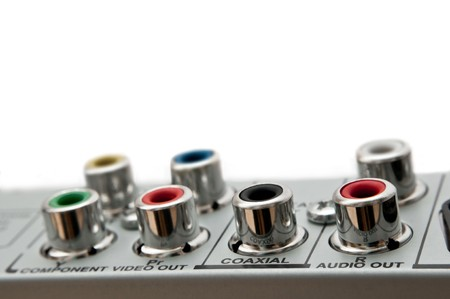Close up capturing audio visual sockets on the rear of an electrical device. White background. Stock Photo - 7151719