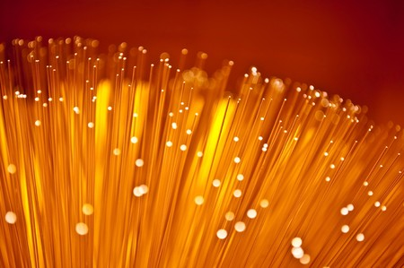 Close up of the ends of many fibre optic light strands with vibrant colours. photo