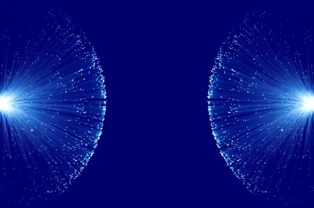 Two groups of illuminated blue fibre optic light strands eminating from the left and right image border against a blue background photo