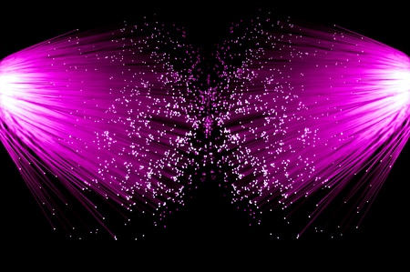 emanating: Two illuminated groups of bright pink fibre optic strands emanating from the left and right of the image. Black background.