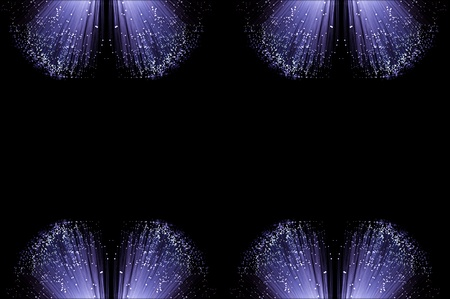 Eight small groups of illuminated fiber optic light strands arranged along the top and bottom border of the image with black background. photo