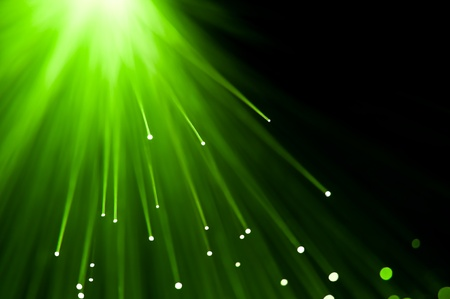Abstract green fibre optic lights against a black background. photo