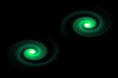 Two green light swirls against black background photo