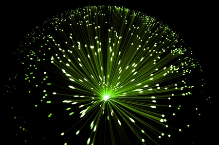 Abstract style overhead view of illuminated fiber optic strands against black. Stock Photo - 8949514