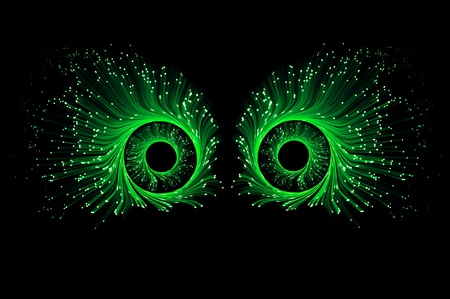 Two eyes composed from illuminated green fibre optics against a black background. photo