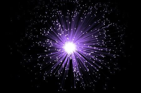 fiberoptic: Overhead capturing many illuminated violet fiber optic light strands against black background Stock Photo