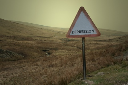 A single British road sign with the word 'depression' against a bleak moorland landscape Stock Photo - 9266085