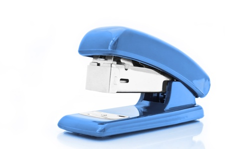 Close up of a single blue office stapler isolated over white photo