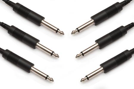 Close up capturing several Jack Plugs arranged over white Stock Photo - 9892725