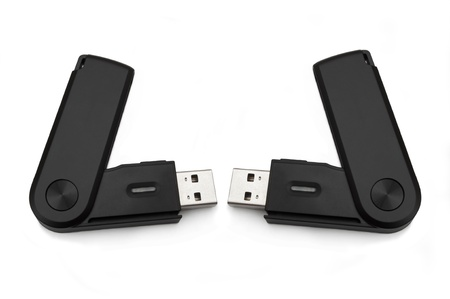 convertor: Close up of two black usb sd card adaptors arranged over white