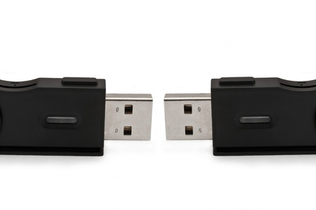 Close and low level capturing two usb sd adaptors arranged over white photo
