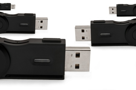 Close and low level capturing several usb sd adaptors arranged over white photo