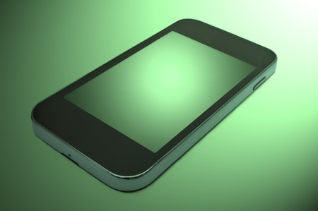 pda: Close up and low level capturing a single unbranded smart phone arranged over a green light effect Stock Photo