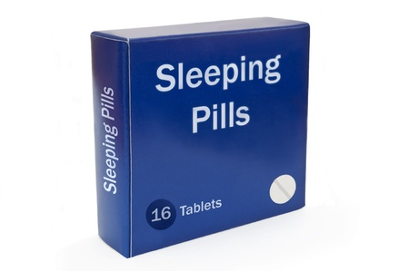 pill box: Close and low level angle capturing a blue medication pack with the words Sleeping Pills arranged over white.
