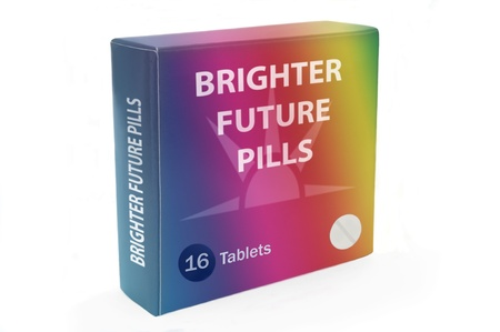 pill box: Close and low level angle capturing a multicoloured medication pack with the words,Brighter Future Pills, arranged over white.