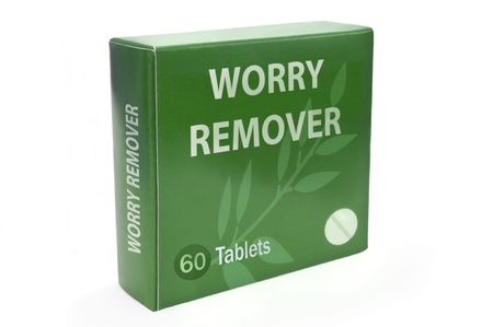 Close up of a green box with the words,worry remover, arranged over white. Stock Photo - 10739441